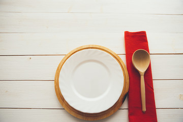 Wooden spoon and dish over wooden table