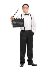 Mature movie director holding a clapperboard