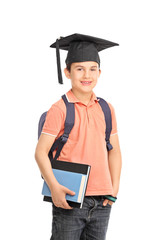 Schoolboy with a graduation hat holding books