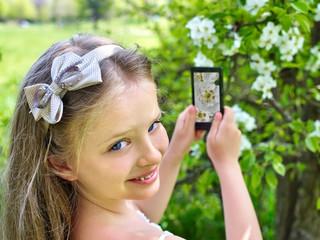 Girl snapshot blossoming tree.