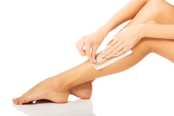 Woman waxing her leg