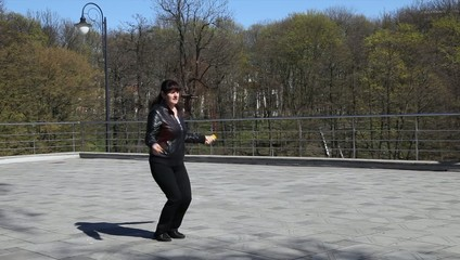 beautiful woman jumping rope in a city park