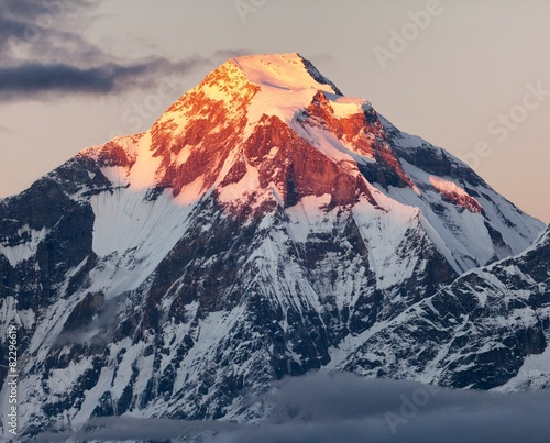 mount Dhaulagiri with sunshine colored mountain top