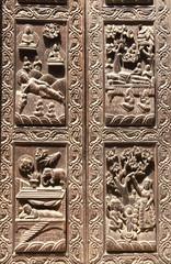 Wooden door with scenes from life of Buddha, Kathmandu, Nepal