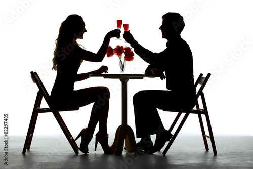 Leinwandbild Motiv Couple Having Dinner With Wine Glass On Table
