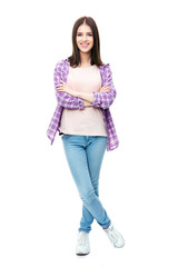 Smiling female student standing with arms folded