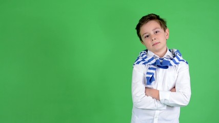 child boy smiles to camera (folded arms) - green screen - studio