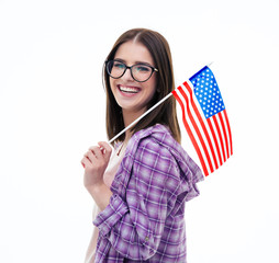Happy young female student holding US flag