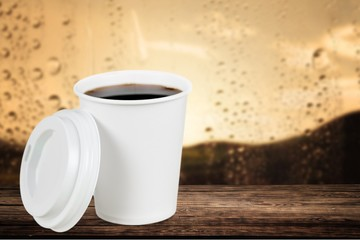 Cup. Opened take-out coffee with cup holder. Isolated on a white
