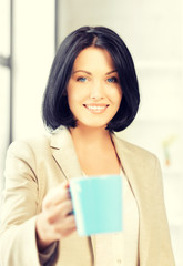 lovely businesswoman with mug