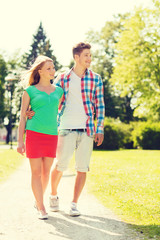 smiling couple walking in park