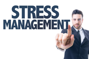 Business man pointing the text: Stress Management