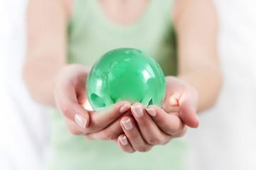 Green Earth Globe in Human Hands