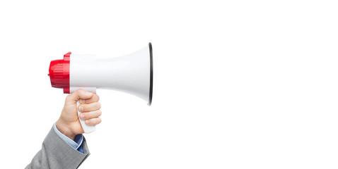 businessman in suit speaking to megaphone