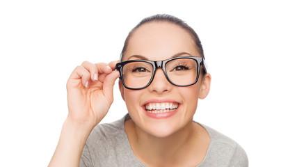asian woman adjusting eyeglasses