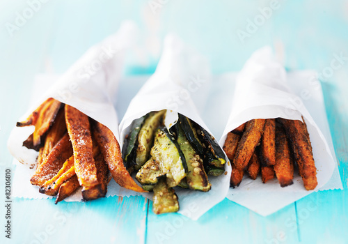 Poster trio of carrot, zucchini, and sweet potato fries shot head on