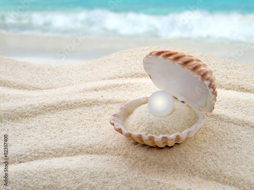 Shell with a pearl on the beach - 82307400