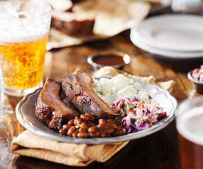 barbecued spare ribs with coleslaw and fixings