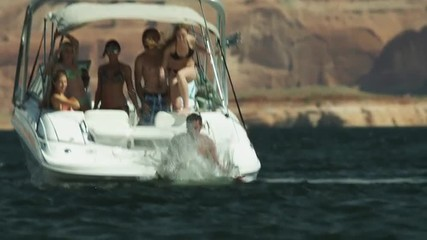 SLO MO WS People jumping to Lake Powell from boat / Utah, USA