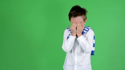 young handsome child boy crying - green screen - studio