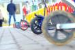 Leinwandbild Motiv Parking of scooters near a school
