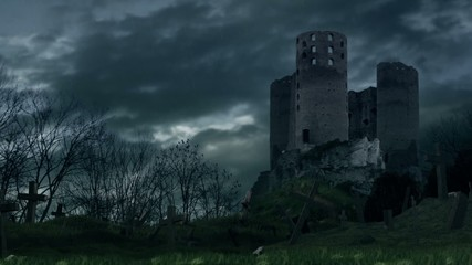 Dark castle and cemetery during storm.