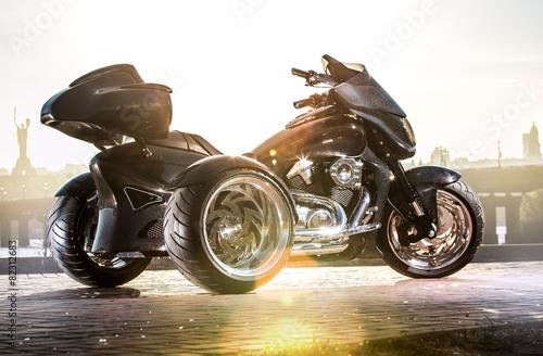 Black trike standing on the light street - 82312683