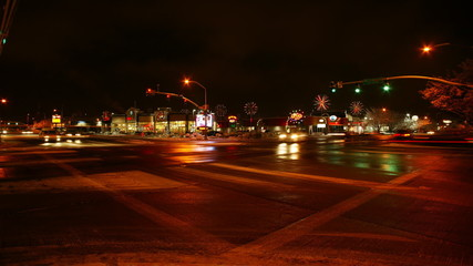 A busy intersection at night