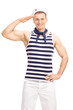 Leinwandbild Motiv Handsome sailor making a salute gesture