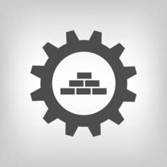 Grey construction logo wih gear wheel and bricks