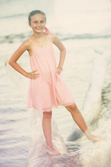 Summer, portrait of fashion young girl on the beach