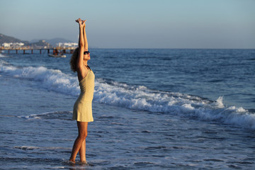 Beautiful young woman on sea water. Relax, vacation