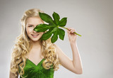 Woman Face and Green Leaf, Hair Organic Treatment and Skin Care