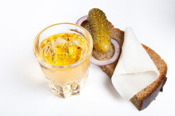 Vodka in glass with black bread, pickled, onion and bit of lard