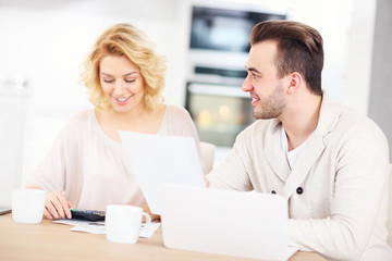 Couple working on home budget