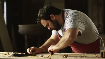carpenter woodworking on a door