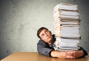 Stack. Office worker holding paperwork stack