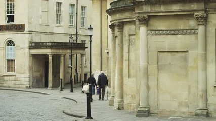 WS Senior couple walking down street / Bath,Somerset, UK