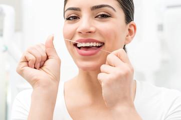 Floss its help me to care my teeth.
