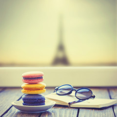 Macarons and little notebook with glasses