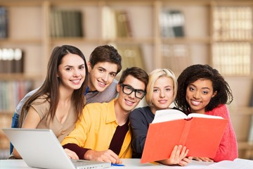Teens. Education concept - students reading book at school