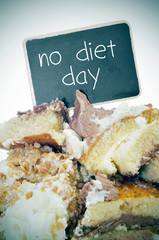 pieces of cake and text no diet day on a signboard