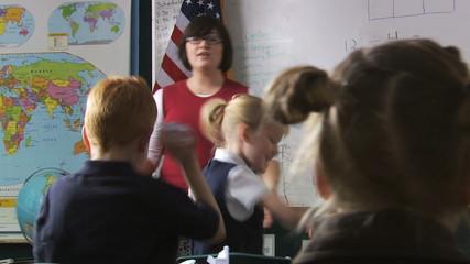 teacher calming down her class