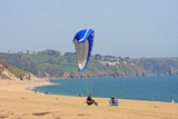 paraglider landing on Strete beach