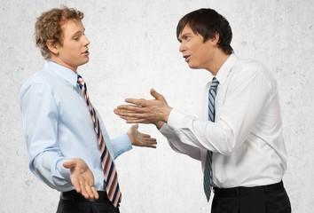 Arguing. Business disagreement