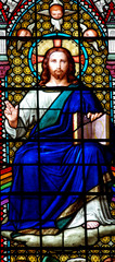 Jesus Christ with a book in stained glass