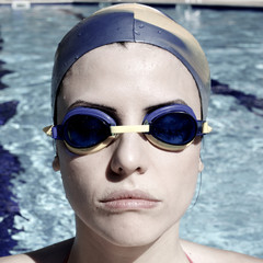 Portrait of gorgeous female swimmer ready for olimpic gamesF
