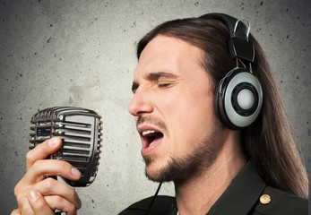 Singer. Young man singing with microphone