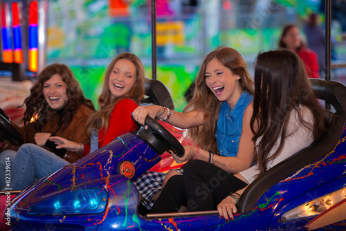 Poster carnival bumper ride group of teens