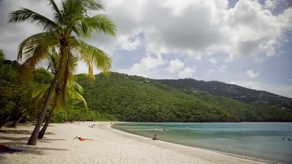 T/L WS People relaxing on beach / St. Thomas, United States Virgin Islands
